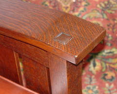 Detail pinned thru-tenon through top of the arm.