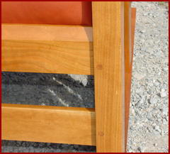Close-up image of the beveled front seat rail and the doweled front leg, mortice and tenon construction.