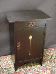 Single inlaid cabinet in Ebony stain.