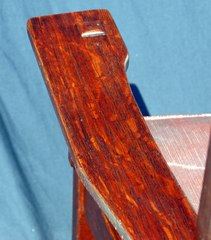 Detail quarter sawed white oak in left arm.,