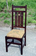Single chair in darker stain.