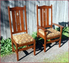 Arm chair and side chair from a lighter stained set of chairs upholstered in fabric.