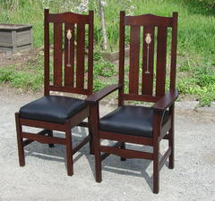 Arm chair and side chair shown together.