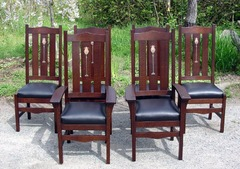 Shown in group of six including two arm chairs. Darker stain.