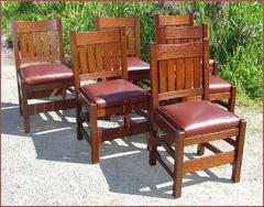 "While we make an accurate replica of the Gustav Stickley ""v-back"" dining chair, we also make our larger version such as the set shown.  Available with wrap-aroung leather cushions or the deep drop-in cushions as shown with this set."