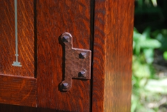 Close-up hand hammered hinge hardware.