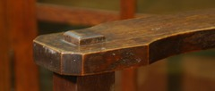Detail clip-corner arm with bold through-tenon.
