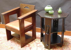 Shown next to a replica Limbert Cafe chair.