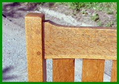 Detail showing double-pinned mortise and tenon construction of the crest rail and top of leg.