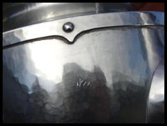 Close-up of scratches on side of teapot.