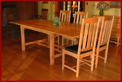 Shown with the two leaves installed and two chairs at the end of the table.