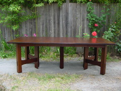 Table shown open with four leaves.  Measures 8' long.