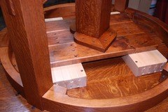 Detail maple table glides viewed from below.