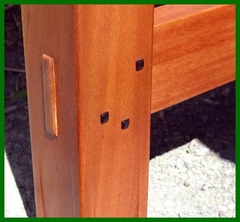Detail through-tenon construction and square Ebony pegs.
