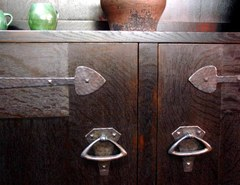Close-up hand-hammered door hardware.