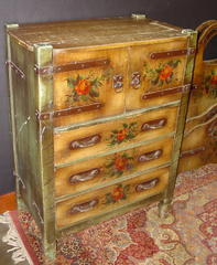Large Highboy with three drawers below two doors with strap hinges concealing two interior drawers.
