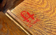 Gustav Stickley red decal signature inside left side, circa 1905-1912.