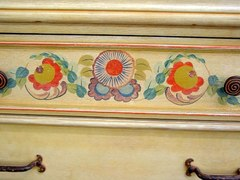 Close-up of hand painted floral decoration on drawer front.