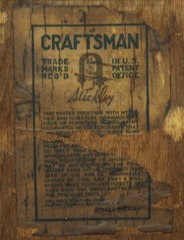 Gustav Stickley signature paper label and guarantee on back of cabinet.