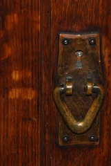 Original patina to the Gustav Stickley hand hammered copper door pull hardware.