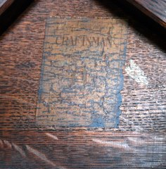 Gustav Stickley paper label signature under the top of the table.