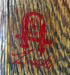 Close up Gustav Stickley signature red decal used circa 1905-1912.