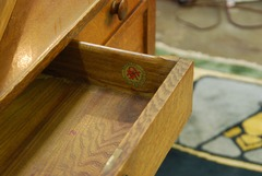 Top center drawer extended, Stickley Associated Cabinetmakers co-joined decal signature, 1916-1919.
