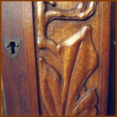 Close-up heart shaped escutcheon & relief carving.