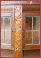Detail leaded doors & carved panel.