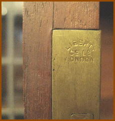 "Close-up one of four brass mortise locks stamped: ""Liberty & Co., London."""
