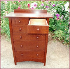 Shown with one drawer fully extended. We build drawers with the option of traditional drawers with wooden center guides under the drawers or with high quality contemporary full extention ball bearing slides, rated for extra heavy weight loads. Some collectors prefer the appearance and authenticity of traditional drawers while others prefer the convenience of a drawer that fully extends and the ease of the ball bearing slides when using the drawer.