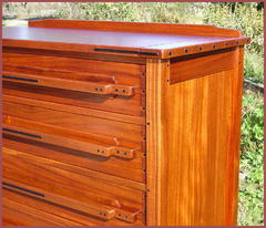 Close-up of Drawer fronts with Ebony caps and dresser top with Ebony splines.