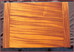 View of the beautiful and luminescent grain of the Mahogany top.