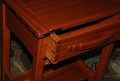 Detail of the through dovetail drawer construction and the hand carved drawer pull.