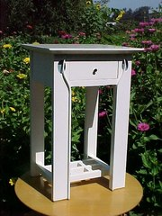 Mackintosh inspired nightstand in white lacquer.
