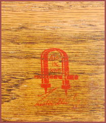 Red decal signature in drawer.