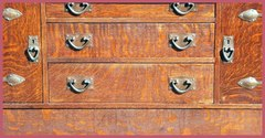 Drawer fronts and original hand-hammered hardware.