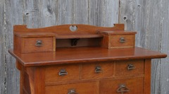 Detail upper drawers, corbel supported shelf and heart shaped cut out design.