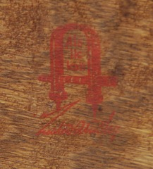 Close-up of red decal Gustav Stickley signature, circa 1905-1912.