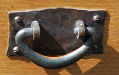 Detail original hand hammered copper pull with original patina.