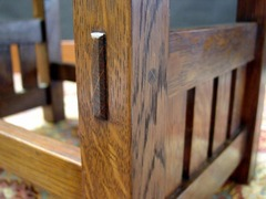 Detail beveled exposed pinned through-tenon.