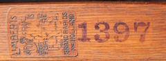 Close up image branded Limbert signature and stenciled catalogue number 1397.