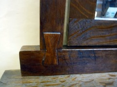 Butterfly-key joinery at mirror support.