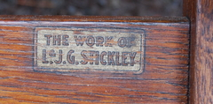 "L & J G Stickley decal signature reading ""The Work of L & J G Stickley"". 1912-1918. All 8 chairs are signed."