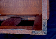 Detail tongue and groove mitered corner joinery.