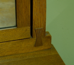 Beautiful and functional raised butterfly key joinery on the mirror support.