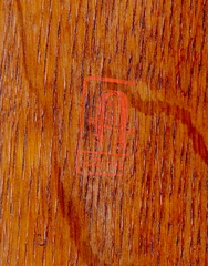 "Early Gustav Stickley red decal signature, ""Stickley"" in a box below a joiners compass surrounding the words ""Als Ik Khan"".  1902-1904."