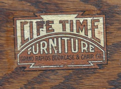 Original Lifetime Furniture Co. decal signature example to compare with the remnant decal remaining on this desk.  (This is not the decal on this desk, comparison only, please view other image of signature.)