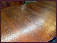 "View of the table top with the leaves installed, illustrating the striking, yet not garrish, quarter-sawn ""ray-flake"" grain."