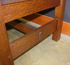 Close-up of large pinned thru-tenon at the side stretcher, note pinned tenon construction on the legs also.
